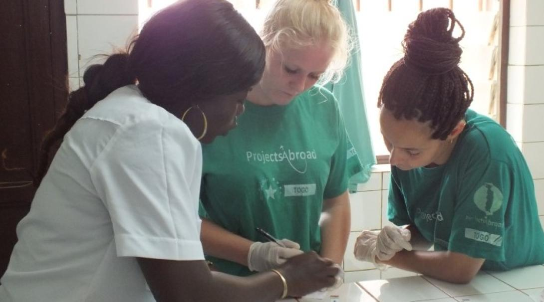 Medical students observing a doctor in Togo